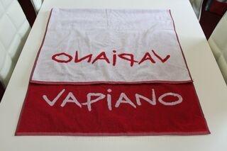 Kudottu logolla pyyheliina Vapiano